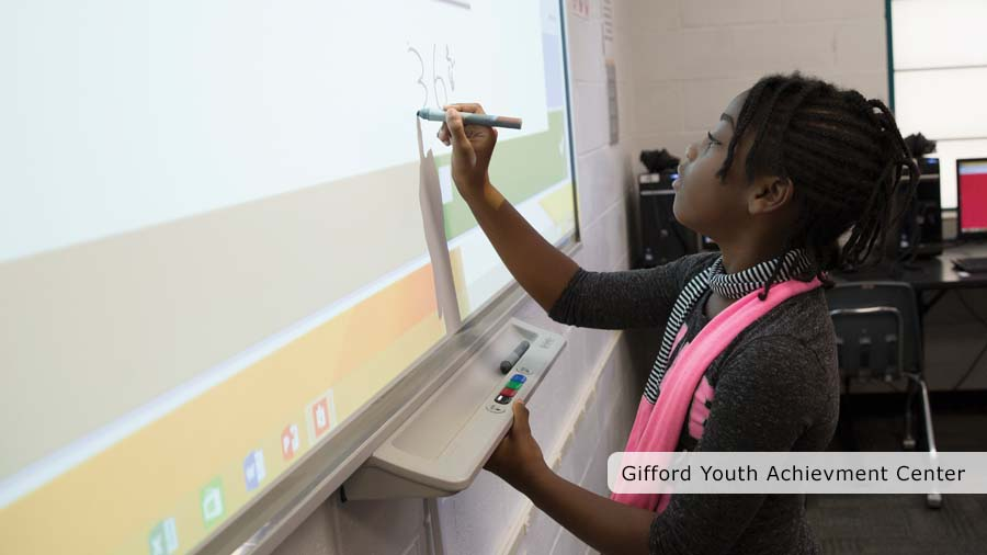 Gifford Youth Achievement Center Girl using smart board