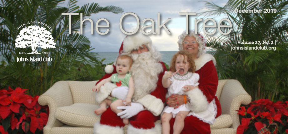 The Oak Tree magazine cover with logo over image of Santa and Mrs. Claus holding children