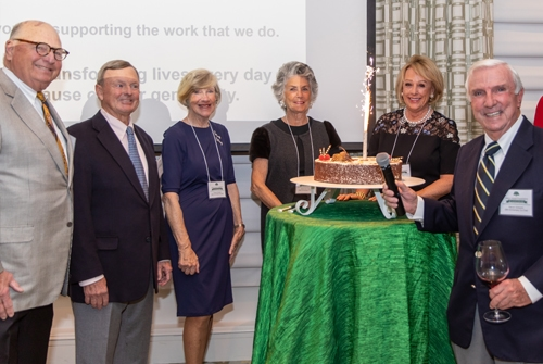 John's Island Foundation 20th anniversary co-chairs light a candle on the anniversary cake (left to right: Ron Rosner, Ned Dayton, Virginia Schwerin, Sherry Ann Dayton, Nancy Rosner, and Warren Schwerin)