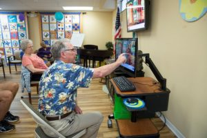 Alzheimer & Parkinson Association of Indian River County elders looking at computer screen