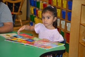 Kindergarten Readiness Collaborative girl reading a book