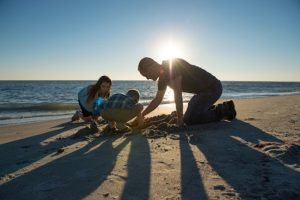 Safe Families for Children father and 2 kids playing in beach sand